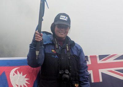 Local village woman wearing HGA hat